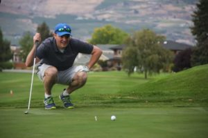 man playing golf in chelan